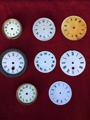 A Collection of 8 Antique Clock Faces