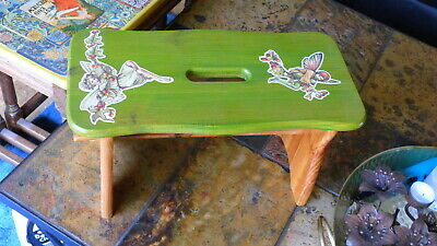 Old wooden small stool with flower fairies images