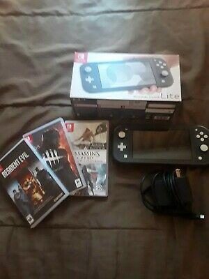 Nintendo Switch Lite - Gray ,with box and 3 games read description!