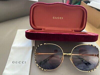 Gucci gold round sunglasses with case in immaculate condition