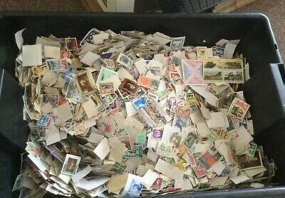 1000 Stamps From Hoard Of Millions Stamps Collected worldwide off paper stamps