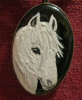 Horse, white, hand-painted on oval metal with black inset pendant/bead/necklace