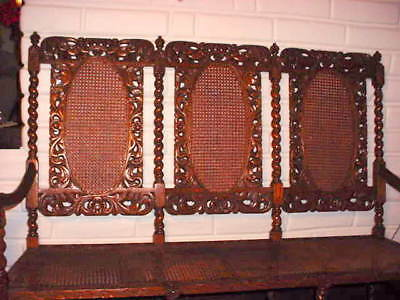 Antique Meticulously Carved Oak Three-Seat Bench With Cane Back And Seats