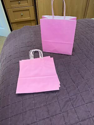 D) 5 Pale Pink Party Paper Gift Bags.