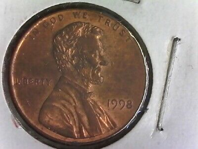1998 penny coin with a WIDE AM