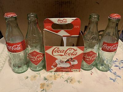 "2 8.5 oz Holiday 2012 Coca Cola Bottles With Carton  And 2 ""125 Years"" Bottles"