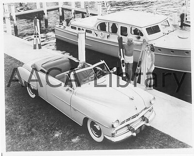 1952 Dodge D42 Coronet Convertible Coupe near boat, Factory Photo (Ref. # 38681)