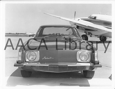 1964 Studebaker Avanti in front of plane, Factory Photograph (Ref. # 25554)