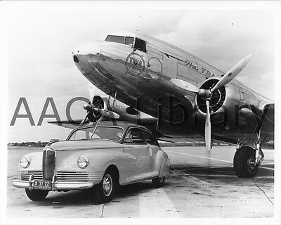 1942 Packard Clipper Coupe w/ TWA Plane, Factory Photo / Picture (Ref. #61924)