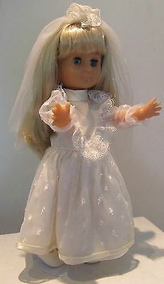 12 inches Bride, Unmarked, All vinyl, comes with stand