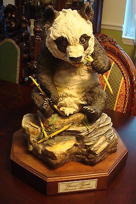 """Boehm Giant Panda eating bamboo, 14"""" tall, sitting on a rock, with wooden base"""