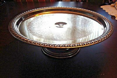 Meridian Silverplate pedestal cake plate, roped borders, carved floral center