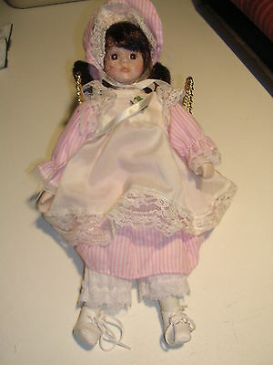 Anco Porcelain Doll With Dark Hair from 1990's with White and Pink Dress