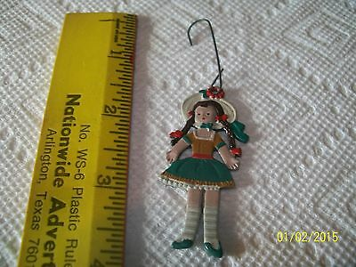 OLD METAL CHRISTMAS ORNAMENT-2 SIDED LITTLE GIRL WITH PIG TAILS ,HAT,GREEN DRESS