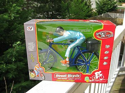 Electronic Musical Bicycle Toy - Street Bicycle.  Riding Cyclist .NEW IN A BOX