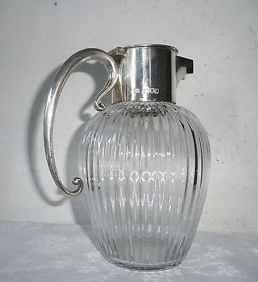 ANTIQUE GLASS JUG  with STERLING SILVER TOP and HANDLE HALLMARKED: LONDON 1899