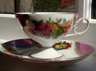 Napco tea cup & saucer. Pink & white with fruit motif and gilding. IYD256