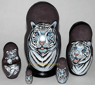 Snow Tigers on the Set of Five Russian Nesting Dolls.