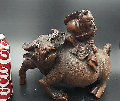 A Large Chinese Wood Sculpture Of A Boy On Buffalo