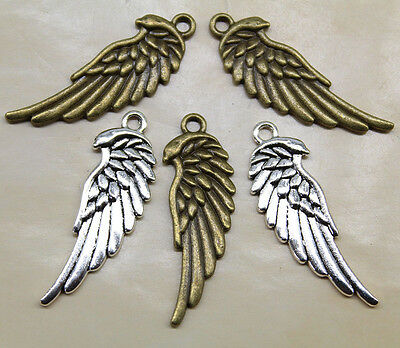 Free ship retro style wings of the bird head alloy charms pendants
