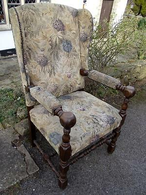 A Stunning Victorian Era Chunky Carved Wooden Wingback Armchair with Upholstery