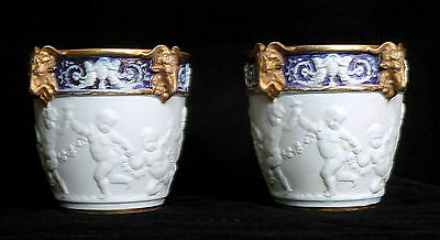 VERY RARE PAIR OF ANTIQUE SEVRES TYPE BISCUIT PORCELAIN CACHE POTS, RAMS' HEADS
