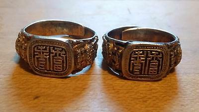 PAIR ANTIQUE SIGNED CHINESE GOLD  RINGS WITH CHARACTERS AND DRAGONS