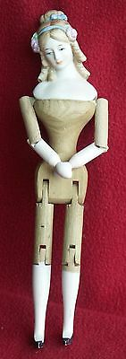 ANTIQUE DOLL REPRODUCTION: WOODEN BODY & PORCELAIN HEAD
