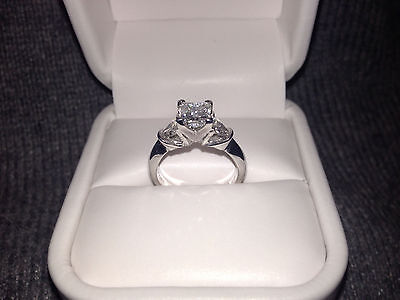 Platinum princess cut engagement ring with trillions, 1.36ct., E in color, GIA