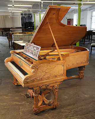 Unique,1895, Bechstein Model C grand piano with an ornately carved, walnut case