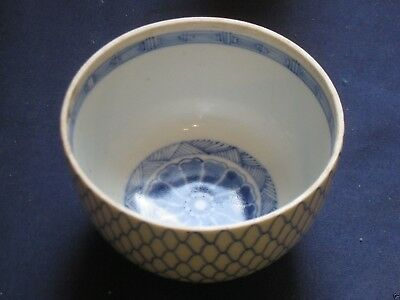 intricate japanese porcelain blue and white rice bowl