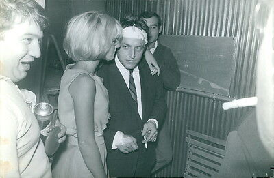 Vintage photo of Sylvie Vartan standing with a man. -