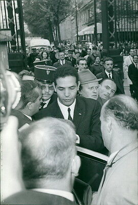 Vintage photo of Man surrounded with people. -