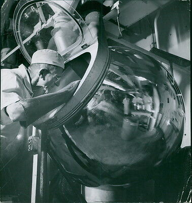 Vintage photo of A worker working in milk factory.  -