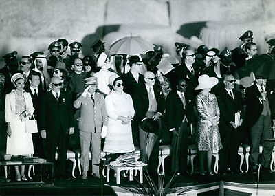 Vintage photo of Farah Pahlavi in ceremony with other people.  -