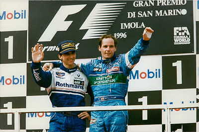Vintage photo of F1 drivers Damon Hill and Gerhard Berger waving at the crowd d