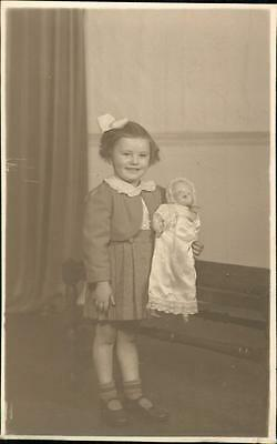 Young girl holding doll 'Hall' family collection, Walsall. John W Moore  qq437