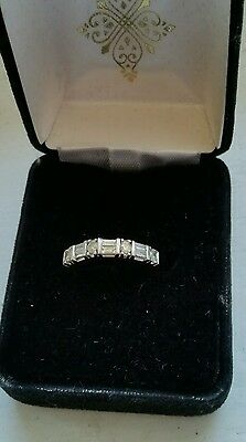 .50 ct 7 stones round and baguette 14k white gold ladies wedding band. Size 6
