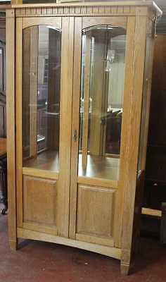 Neat Medium Oak Cabinet with Glazed doors and shelves for display.