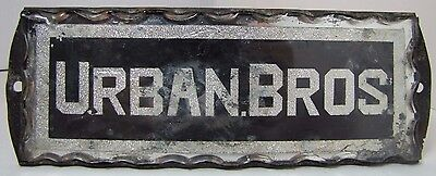 Antique URBAN BROS Chip Glass Advertising Sign tin backed scalloped reflective