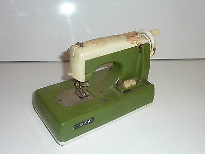 vintage zig zag minature sewing machine toy battery operated japan