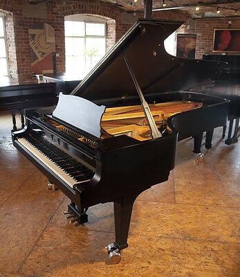 Steinway Model D concert grand piano with a satin, black case