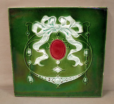 An English Art Nouveau Tile- Impressed Majolica  - Jewelled Design
