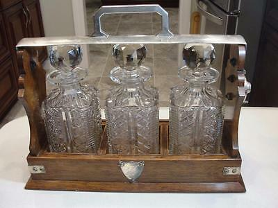 English Oak Tantalus Set w/ Silver Plated mounts & Three Blown Crystal Decanters
