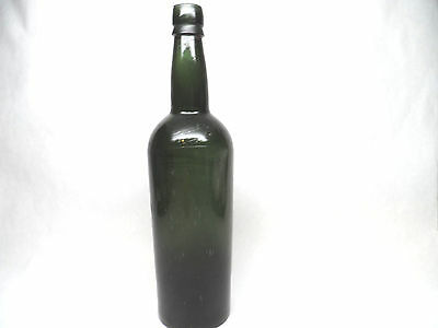 12 inch black glass bottle, green with lots of bubbles.