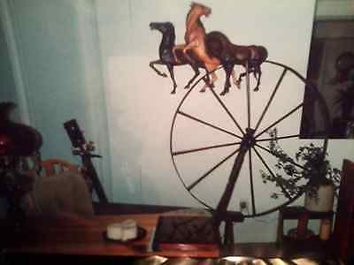 Antique spinning wheel with primitive (was working apparatus) aging verification