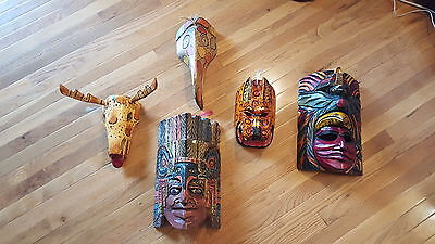 Collection hand carved wood face masks Cost Rica Nicaragua