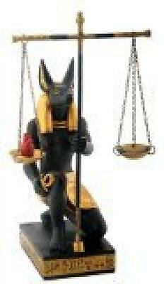 Black Collectible Figurines and Gold Anubis Scales of Justice