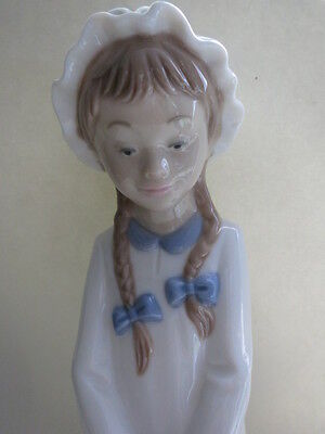 Lladro Nao figurine, tall girl with plaits, carrying basket of sweets