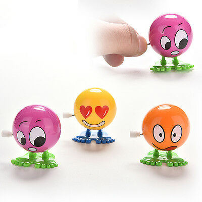 1 Pcs Wind up Face Colorful Funny  Cartoon Somersault Running Clockwork  Toys FT